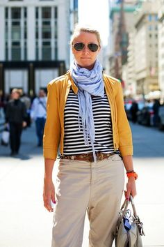 Great style.  Love the mix of classic khaki, stripes and pop of color.  Oh!  And the aviators!!