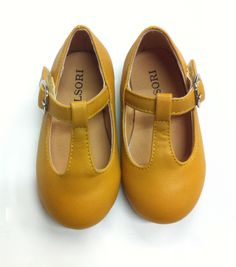 Yellow leather mary janes.