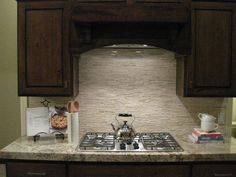 Smaller/Subtle Stone Backplash - Love the dark cabinets, light countertop and stone backsplash, add a little color though