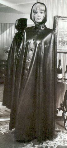 Caped in soft black latex. Vintage ecstasy!