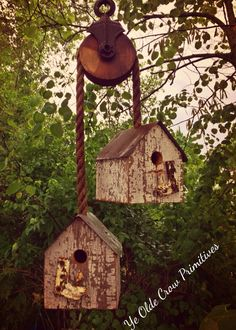 Beautiful bird houses on A antique pulley made from reclaimed Barn Wood in my gardens Ye Olde Crow Primitives