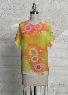 With a chic geometric cut, this top is the modern upgrade to your classic tee. Vida Design, My Design, Paint Icon, Silk T Shirt, Expressive Art, Wool Scarf, Handmade Clothes, Geraniums, Wearable Art