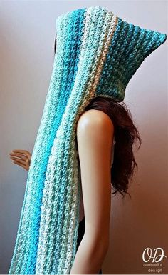 Faerie Mist Hooded Scarf Free Crochet Pattern Although it uses basic stitches, it`s their placement that creates a beautiful texture. This hooded scarf looks stunning in blue ombre but give other colors a go as well. Hooded Scarf Pattern, Crochet Hooded Scarf, Crochet Scarves, Crochet Clothes, All Free Crochet, Knit Crochet, Crochet Hats, Double Crochet, Single Crochet
