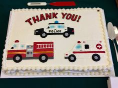 Hand drawn police, fire and ambulance vehicles on our sheet cake.