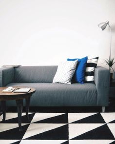 grey sofa and blue cushions