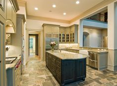 I like the sage cabinet color, and dark stain color on the island.  Also the floor is really pretty.