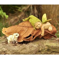 Sleeping Baby Fairy with a Baby Rabbit. www.teeliesfairygarden.com . . . This sleeping baby fairy is hugging a leaf and the little bunny was curious why. Is he having a bad dream? #babyfairy