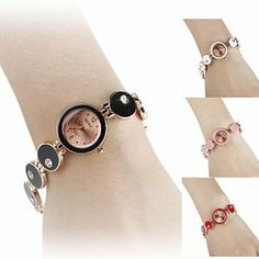 Tanboo Women's Alloy Analog Quartz Bracelet Watch (Assorted Colors) by Tanboo. $9.99. Fashionable Watches. Bracelet Watches. Women's Watche. Gender:Women'sMovement:QuartzDisplay:AnalogStyle:Bracelet WatchesType:Fashionable WatchesBand Material:AlloyBand Color:Red, Black, White, PinkCase Diameter Approx (cm):2Case Thickness Approx (cm):0.6Band Length Approx (cm):17.7Band Width Approx (cm):0.8