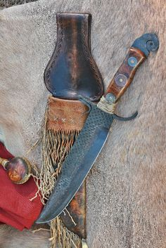 41 Cent Bowie, forged from vintage horse rasp. Circa 1850's. Coins inlet into the handle with pitch glue. Deer rawhide sheath is wrapped with braintan deerskin.  Awesome 12 inch blade with tapered tang.  Mountain man, buckskinner, rendezvous, trapper, bowie, file knife, frontier blade, primitive