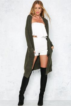 The Midas Touch Cardigan turns every outfit into pure fashion gold! Made from a luscious, plush to the the touch mid weight material, this style has full length sleeves with tapered cuffs. The perfect transeasonal layering piece, we love teaming ours with denim miniskirts, white tee's and a wool hat for the ultimate laid back look!  Cardigan. Not lined. Cold hand wash only. Model is standard S and is wearing S. True to size. Stretchy fabric. Cotton/polyester.