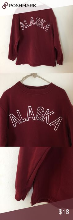 Alaska Big Red Sweater Rather be in Alaska? This is for you. Loose fit with lil slits at the bottom on the sides. Best for a small-medium Brandy Melville Sweaters Crew & Scoop Necks