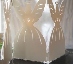 Lift your winter holiday spirits with these bright angels. Place it against your window or on a shelf for warm light and cosy angel silhouettes. Merry Christmas Everyone, Christmas Wishes, Christmas Angels, White Christmas, Christmas Time, Christmas Ideas, Xmas, Sparkle Decorations, Christmas Decorations