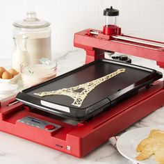 You either draw your own design with the PancakePainter software or use one of the designs on their website (though the selection is really small). You then transfer the design onto a SD card (not included with the set), insert the card into the machine, and watch your breakfast masterpiece come to life.Get it for $299.99 (or $295 for the black).