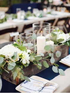 Perfect rustic centerpiece for oblong/rectangular guest tables. They're not too tall, so guests can still see each when speaking. I'm in love with eucalyptus this year (and every year).