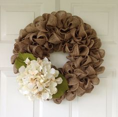 Tan burlap wreath accented with a cream hydrangea by SimpleCountryBurlap on Etsy https://www.etsy.com/listing/226238814/tan-burlap-wreath-accented-with-a-cream