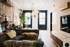 "Living Room with 70"" TV, designer furnishings, vintage artifacts"