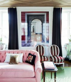 Never thought of using pink on a sofa. Pretty. Especially with the black needlepoint pillow.