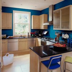 Neutral cabinets look anything but when backed with a jewel-tone blue. | Lapis Enamel (E22-1), @dutchboypaint