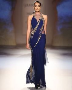 Midnight Blue Sari Gown with Golden Embellishments by Gaurav Gupta  a sari gown is an interesting concept...