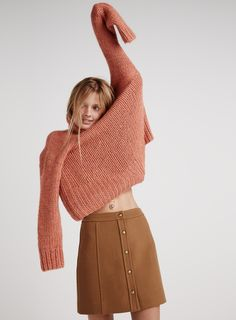 madewell snap-front mini skirt worn with the connection sweater.