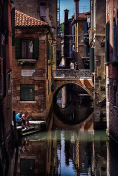 .VENICE, ITALY~ A quiet moment on a small canal in a residential area of Venice°°