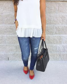 Pleated top with distressed denim and red flats