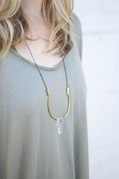Sister Golden | Chelsea Long Arc Necklace – Handcrafted in Milwaukee, WI, this long, lightweight necklace is a jewelry box staple! Each unique piece of clear quartz is meticulously handpicked and serve as