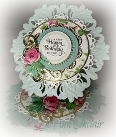 Easel card, made with dies from Spellbinders. Paper, flowers and sentiment are from Anna Griffin.