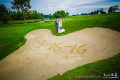 Bride and groom stand on golf course with wedding date written in sand #Michiganwedding #Chicagowedding #MikeStaffProductions #wedding #reception #weddingphotography #weddingdj #weddingvideography #wedding #photos #wedding #pictures #ideas #planning #DJ #photography #bride #groom