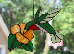 Stained Glass Hummingbird Suncatcher by Imakeglass on Etsy, $40.00
