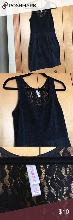 Xhilaration Lace LBD Tank top lace dress, size medium. Runs true to size but better for someone who is a small/medium than medium/large. Top of dress is lined with lace on top but in back the lace is a bit see through as pictured. Bottom of dress is plain black material with 2 pockets on sides as pictured. Worn 2-3x and in good condition. Dress has side zipper. Xhilaration Dresses Mini