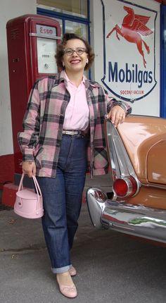 Oh how I adore her pink Pendleton jacket, and vintage handbag.