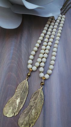 Long beaded feather necklace. Boho feather by AllAboutEveCreations