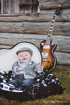 little guy in guitar case by log cabin.  Kristen Rice Photography