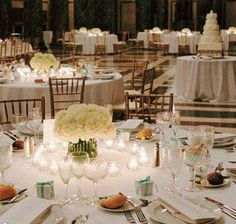 Inexpensive white_carnation centerpieces_alternate low and tall