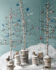 When Hannah Milman, our executive crafts director, created this tree, she was envisioning a winter party in the woods—complete with birds and other creatures decorating it (much the way the birds and mice dressed Cinderella for the ball). Glittered birds swoop in with silver ribbons to wind through the branches. The trees themselves are fashioned from birch logs and dried twigs. Woodland animals, hansatoysusa.com Get the Glittered Birds, Nests, and Mushrooms How-To