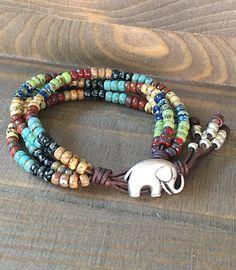 Items similar to Elephant Bracelet/ Elephant Leather Wrap Bracelet For Women/ Seed Bead Leather Wrap Bracelet/ Beaded Boho Wrap Bracelet. on Etsy Leather Jewelry, Boho Jewelry, Jewelry Gifts, Beaded Jewelry, Jewelry Accessories, Handmade Jewelry, Beaded Bracelets, Strand Bracelet, Making Bracelets