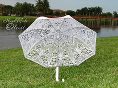 Etsy's Olexis has several #crochet umbrellas for sale including this one with a butterfly filet design.
