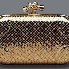 Golden clutch at Bottega Veneta