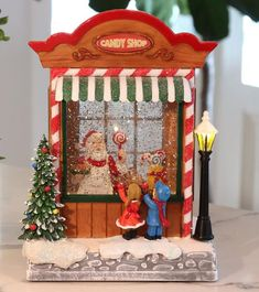 3b95ec25522bb 9 Inch Lighted Musical Candy Shop Holiday Spinning Water Globe - 2436620
