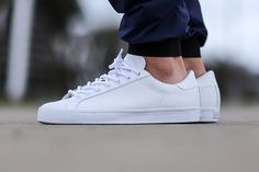 The classic adidas Originals Rod Laver is rendered in the timeless All-White hue for its latest iteration this Spring 2015. Find it now from adidas accounts