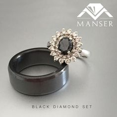 Hers: white gold engagement ring with black diamond centre and white diamond halo. His: black Zirconium men's ring Halo Diamond, Black Diamond, Diamond Rings, His And Hers Rings, Centre, White Gold, Wedding Rings, Engagement Rings, Jewels