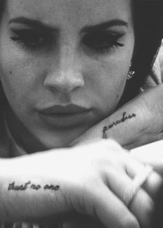 lana del rey tattoos: trust no one & paradise