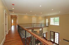 Castlewood Custom Interior unique black detailed railing  #Castlewood #Customhome #Architecture #foyer #interior #interiorhallways #hallways #design #homes #home #dreamhome #dreamspace #railing