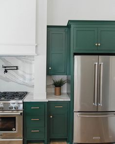 Green cabinets... I would never do this in my kitchen, but I like it.