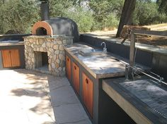 Yes, please!  Pizza oven, and wood fired bbq with a rotissary that raises and lowers!  That is what I need!