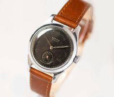 Tomboy watch mid century black face mid size watch by SovietEra