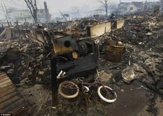 Devastating scene of 100 homes destroyed by fire sparked by downed power cables and fanned by Sandy