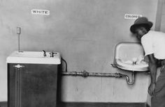 Segregated Water Fountains [1950] Picture of segregated water fountains in North Carolina taken by Elliott Erwitt