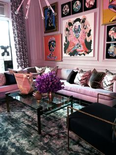 """Designer @abuzzetta painted the walls of his """"fun, crazy parlor room"""" light grey, but you'd never know it from this photo, right? Antonino's custom neon sculpture cast a sexy pink glow over all the surfaces, tinting everything from the walls to the furniture. Thinking about trying a trendy shade in your home but don't want to make a huge commitment? Start with a light neutral on the walls, then pop in colored bulbs.  Antonino Buzzetta Holiday House NYC 2015"""